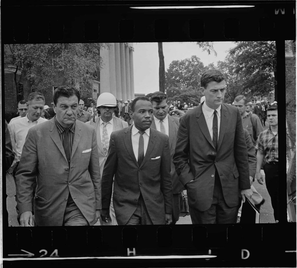James Meredith walking with U.S. Marshalls